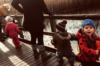 young children on the boardwalk at low barns nature reserve