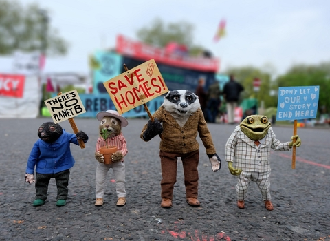 Ratty, Mole, Badger and Toad holding placards asking to save their homes.